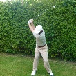 An example of the top of a draw backswing
